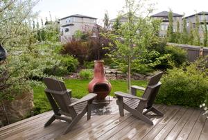 A clay chiminea on a wood deck.