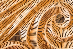 a curving design made from many pieces of wood