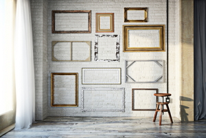 A wall full of vintage picture frames.