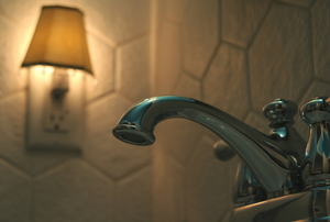 A nightlight in a bathroom with a faucet in the foreground.
