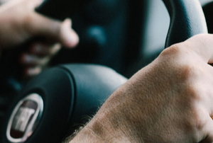 two hands holding a steering wheel