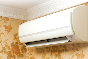 air conditioner mounted to a wall in the corner of a room
