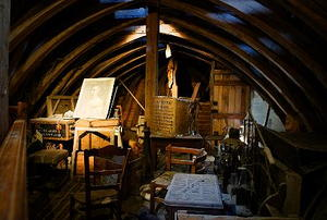 A darkly-lit attic full of antique junk.
