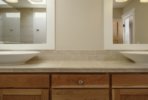 A bathroom with cabinet drawers.