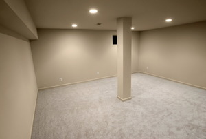 An empty basement, waiting to be decorated.