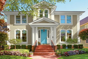home in spring with blue front door