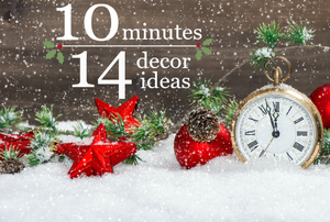 A backdrop of snow, Christmas ornaments, and a clock.