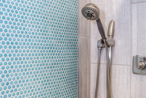 shower stall with tile and stone walls