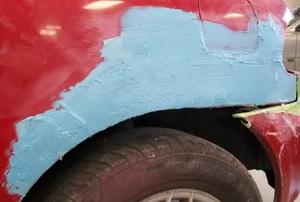A rusty car panel.