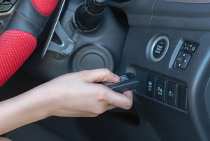 hand holding wireless key to remote engine ignition system