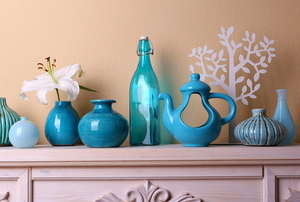 blue ceramic items with floral design on a fireplace mantel