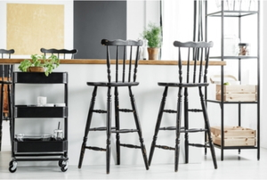 two barstools in a clean, stylish kitchen
