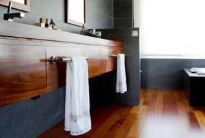 bathroom with hardwood flooring