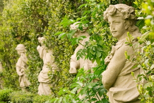 Old statues enveloped by hedges in the Villa Sciara,Rome, Italy