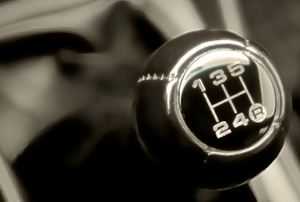The gear shift of a manual transmission.