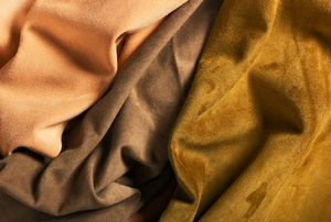Three colors of brown suede fabrics.