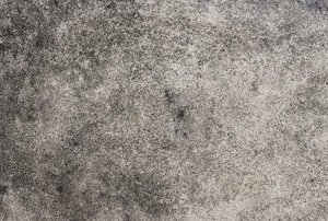 A dirty concrete floor suffering from mold.