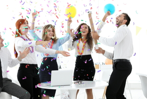 office workers celebrating at a party