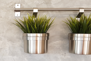 a concrete wall with stainless planters