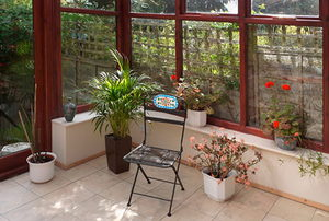 sunroom with plants and chairs