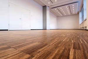 A room with laminate floors.