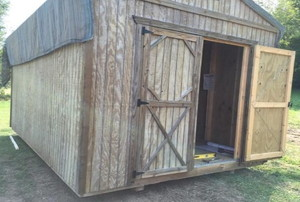 Shed with plywood siding