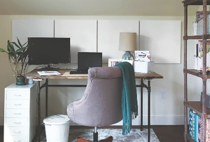 home office with noise-reducing panels installed on wall behind desk