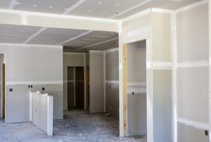 a room with drywall under construction
