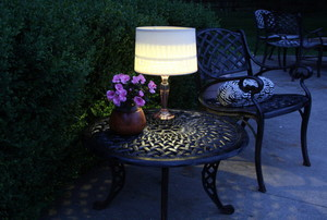 Solar lamp on a bistro set.