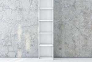 tall, skinny, white chimney cabinet against a marble wall