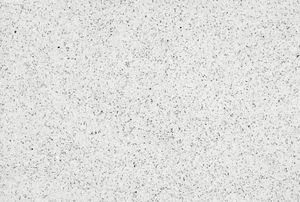 A white and speckled quartz countertop.