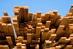 A large stack of wooden planks.