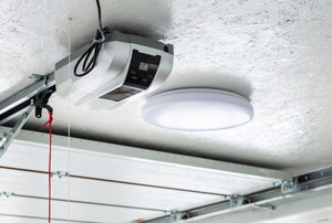 garage door opener device with light