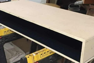 A plywood desk on saw horses