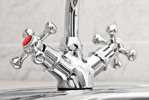 A faucet with cold and hot water.