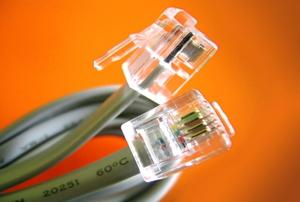 Interlaced phone connector jacks close-up.