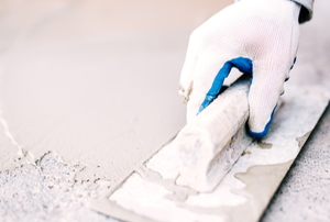 hand smoothing cement surface with flat tool
