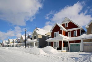 A row of houses covered in snow.