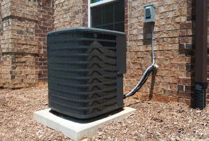 air conditioning unit on a pad outside