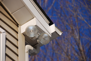 Flood lights mounted to a house