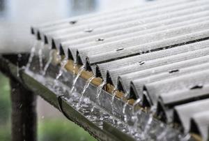 rain running down metal roof