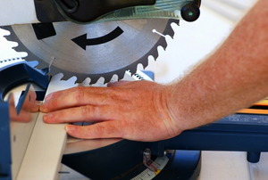 An accident about to happen on a miter saw.