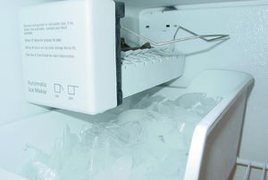 ice maker and tray full of ice