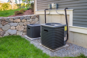 Twin air conditioning units outside of a home.