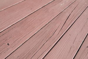 A close-up of a painted wood deck.