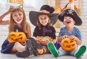 Kids with Halloween pumpkins.