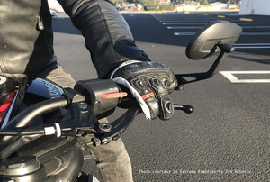 man on motorcycle with hand on the clutch