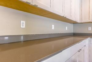 Cabinets with catch hardware.