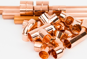 bright copper pipes with fitting connectors