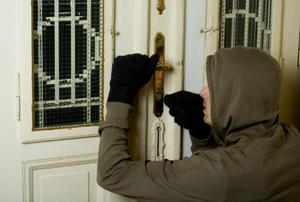 burglar at house door
